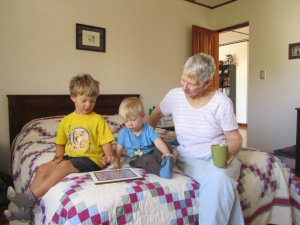 Grandma and boys playing on the iPad.