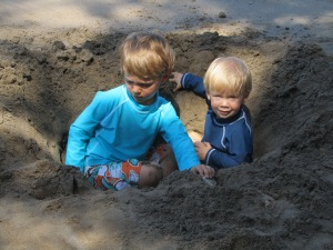 Kylan and Auden in their fort on the beach.