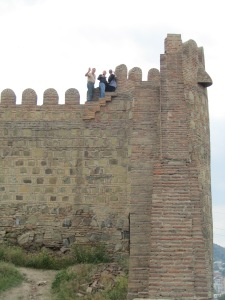 Tom, David and Tasha high up the fortress wall.