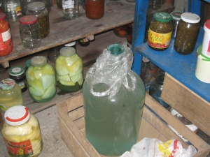 Here we have the 20 liter bottle of ჭაჭა resting with the other canned goods and cheese.