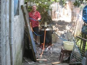 Our host dad, Nodar, tends the fire.