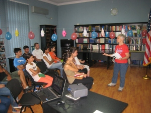 Suzanne at American Corner's Library giving a 4th of July presentation.