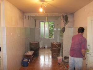 Putting an extension on to the small kitchen area .