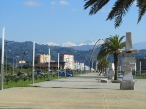 Looking down the street from Heroes Monument toward the snow-capped Caucasus!  Notice the lovely palm tree on the new boulevard.  They grow quickly in this sub-tropical climate.