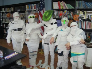"""Halloween """"mummies"""" at the American Corner's Library!  What a great time they had"""