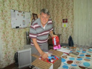 Tom opens a goodie box from friends in the USA.  Maybe we shared some?
